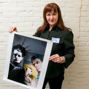 February 18, 2015. Members of the American Society of Media Photographers posed for a portrait with their work, during ASMP's Tenth Annual Fine Art Portfolio Review at the Gay Center in downtown Manhattan.